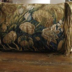 Custom pillow from 17th c Flemish tapestry panel with floral motif, trimmed with antique gold metallic boullion.