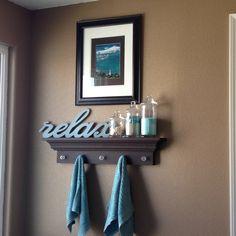 My ocean themed bathroom. Nick hung up my newly painted shelf above my bathtub. I love it.