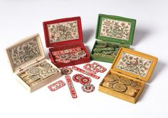 """1740-1760 French Counter boxes at the Victoria and Albert Museum, London - From the curators' comments: """"Card playing was a necessary accomplishment for those hoping to take their place in polite society and all manner of people played at many levels of society. Such counter boxes would have been a luxurious and fashionable accessory for a card player of either sex. The boxes and counters were colour coded to relate to the suits of a pack of cards."""""""