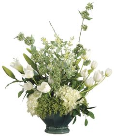 This lovely mixture of white and green florals includes silk hydrangeas, tulips and lily buds that cascade over a teal beaded ceramic container. We use only premium quality materials to assure a natural looking product. Created in the USA.