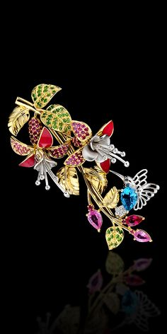 Brooch 10415 Collection: Diamond flowers  18K yellow and white gold, topaz 0,72 ct, diamonds, black diamonds, blue diamonds, rubies, pink sapphires, tsavority, demantoids, enamel.