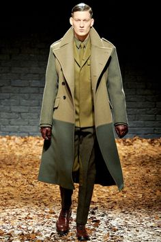 From the late Alexander McQueen. Evocative of British military fashion in the first and second world wars. Lots of sharp plunging lines, rising collars and plunging waists, straight legs, and severe - almost masochistic - use of leather. Change the shoes to riding boots and add a Sam Browne belt and we have a Siegfried Sassoon impersonator.
