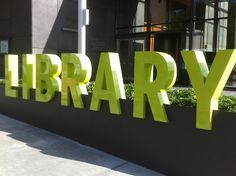 This a setting for all things related to books, authors, writing and libraries. No shelf is too small, unless it has no books. Library Signage, Office Signage, Wayfinding Signage, Parking Design, Signage Design, Facade Design, Library Architecture, School Architecture, Entrance Signage