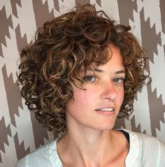 Well-Shaped Chin-Length Curly Bob The soft copper highlights set off each and every curl of the curly hair bob and help to frame the cheekbones and eyes in a dramatic way. The short style is youthful, girly, cute, friendly, and easy to style. Short Curly Haircuts, Curly Hair Cuts, Curly Bob Hairstyles, Short Hair Cuts, Curly Hair Styles, Haircut Short, Short Layered Curly Hair, Short Curls, Long Curly