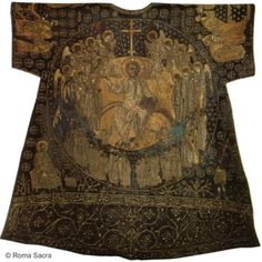 """Dalmatic of Charlemagne"".Eleventh century. Gift of the Patriarch of Constantinople, Isidore of Kiev (1439) to Pope Eugene IV (1431-1447) The only medieval liturgical vestment kept in the Treasury of St Peter's is this dalmatic. It is a masterpiece of the art of embroidery practiced in Constantinople during the eleventh century. It is made entirely in embroidery with gold, silver and colored thread on blue silk with scenes from the Byzantine iconography of the ninth and tenth centuries."