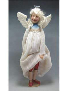 Grandma Angel - Dianne Adams Dolls | original, one of a kind doll created by artist, Dianne Adam. She has a cloth body, her arms & legs are slightly stuffed to make her very pose-able. A variety of fabrics & trims are used in making the clothes. The face & hands are sculpted and cast in marble resin.