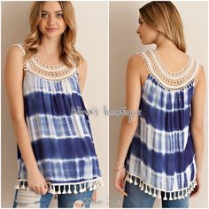 Sleeveless tie dye tops Navy tie dye sleeveless tops has a crochet neckline and fringe details at hem. 100% rayon. Price is firm unless bundled. S(2/4) M(6/8) L(10/12) Tops