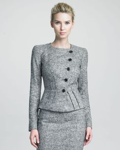 "As seen in S2/Ep16 ""Top of the Hour"", the Armani Collezioni structured jacket from the Fall 2012 Collection. This jacket is tailored to perfection with asymmetric button closure and waist-accentuating trim in Gray heather. Round neckline; button front. Long sleeves. Angled tucks highlight waist. Rounded hem."