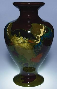 "Rozenburg vase from 1904 decorated with two large birds in a floral setting done in a decidedly Art Nouveau manner. Marked with the Rozenburg ink stamp, artist initials ""HP,"" [W. P. Hartgring] a date flag (1904) and the number 35 all in black slip, the incised notation ""W 249 V"". Oral family history claims this to have been exhibited in the St. Louis World's Fair in 1904. Size is 19 1/2 inches."