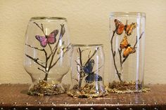 butterfly display cases with upside down vases