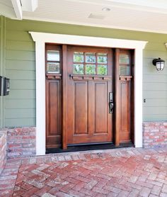 Craftsman-style entry door with two side-lites