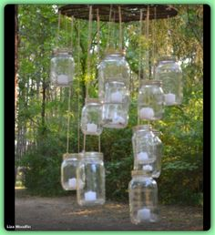 Vintage Chic outdoor wedding decor ideas.... DIY mason jar candle holder - not sure why the photographer couldn't master the focus on his camera, but I like the idea