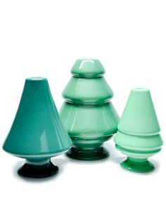 Forest Candle Holder Set by Kahler. The modern shapes of these jadeite colored trees is sublime. I would keep these out all year.