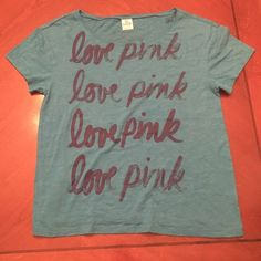 Blue Victoria's Secret Top Never worn. Blue top with blue lettering. Size extra small.   ✨ Always open to reasonable offers and negotiations! Please use offer button. No trades. ✨ PINK Victoria's Secret Tops Tees - Short Sleeve