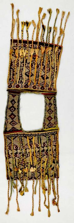 Africa | Saddle bag from the Zaiane Berber people living in the Middle Atlas Mountains | Ca. 1900 - 1950 | wool, silk and cotton | Saddlebags are used by men riding to market, but are made by female members of the family. They are a source of familial pride and a great deal of effort goes into making them. Both front and back of the bags are decorated with extreme care. Lozenge motifs are associated with the eye and are used in many variations by Middle Atlas weavers, notably among the…
