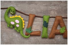 A pretty personalised felt name banner made of different coloured felt, with ribbon for hanging it. A lovely present for a new baby, grandchild or child, to display on their wall or room door for many years to come. Suitable for a birthday, christening, easter gift...  This one is Dinosaur themed, with Palm tree and leaves. :)  * * * * * * * * * * Height of the letters: ≈12 cm (4,8 inch). ONE LETTER PRICE IS $ 9.00. * * * Dinosaur and Palm tree are FREE OF CHARGE! * * * :)  HOW TO ORDER If…