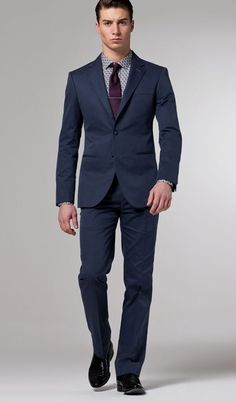 Solid navy suits are perfect for every occasion. You can wear it to many different ways and to many different places. It is great for the office, weddings, social events, and even the suit jacket with jeans.