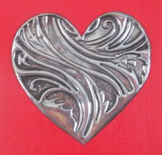 Pewter Embossed heart on red canvas