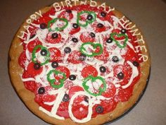 Homemade  Pizza Birthday Cake: This Pizza Birthday Cake I made for my grandson's pizza party birthday. I made chocolate chip cookie dough and baked in a pizza pan.  Red icing all over