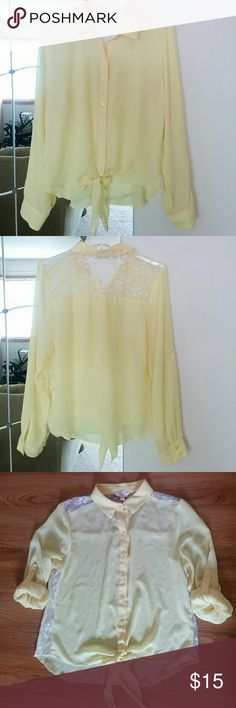 Yellow chiffon button down. Cute and flowy front tie collared top with lace panels on the back and sides. Can be worn long sleeved or rolled up. In good used condition. Candie's Tops Blouses