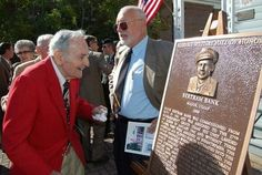 Bataan Death March survivor Bert Bank flashes a big smile Friday, Oct. 31, 2008, at a plaque with his likeness on it during his induction into the Alabama Military Hall of Honor at Marion Military Institute in Marion, Ala. Bank died Monday, June 22, 2009 at age 94.