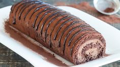 This Chocolate Swiss Roll is a rich, chocolaty and decadent dessert, a rewarding treat for chocolate lovers. A chocolate sponge cake is filled with a chocolate mousse filling and drizzled with chocolate ganache on top. It is simply heavenly delicious. Chocolate Swiss Roll Recipe, Chocolate Roll, Chocolate Filling, Chocolate Lovers, Melting Chocolate, Chocolate Recipes, Chocolate Ganache, Chocolate Chips, Strawberry Shortcake Cheesecake