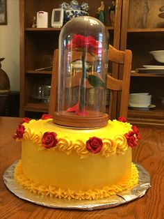 Beauty and the Beast cake with floating rose.