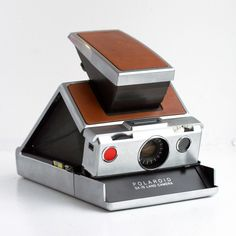A precursor to today's digital era, Polaroid's iconic 1972 SX-70 Land Camera. A key work accessory for many years.