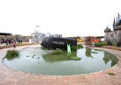 Bansky and Dismaland a Dystopian Modern Urban Theme Park  An armored police riot van built to serve on the streets of Northern Ireland in Water Canon Creek