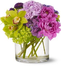 Watercolor Beauty: Green cymbidium orchids and viburnum, purple dahlias, hydrangea and Matsumoto asters and lavender carnations – accented with seafoam statice