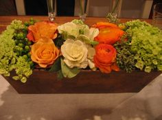 captivating table centerpiece decoration with orange, white and red flowers in rectangle wooden vase, Captivating Thanksgiving Centerpiece Design Ideas