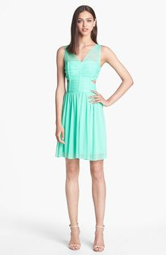 Pretty + a little sexy: Mint dress with cutouts