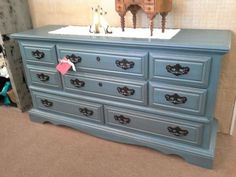 SOLD - This is a wooden 8 drawer dresser that has been painted blue and distressed. The dark wax has been hand applied. Matching metal hardware complete the look. The dresser that measures 64 inches across the front, 18 inches deep. It stands 33 inches tall. The dresser can be viewed in booth A 8 at Main Street Antique Mall 7260 East Main St ( E of Power Rd ) Mesa 85207  480 9241122open 7 days 10 till 530 Cash or charge 30 day layaway also available