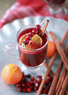 Slow Cooker Cranberry-Orange Mulled Wine recipe - Our favorite way to warm up during the holidays, Crock Pot style.