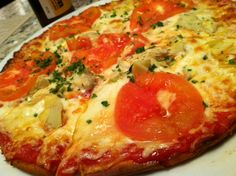 Tomato and artichoke heart pizza from Sauce