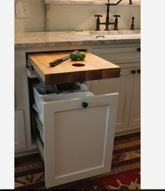 Convenient. A larger hole on the opposite the side of the sink would be ideal. Kitchen With Black Appliances, White Countertop Kitchen, Kitchen Paint, Kitchen Countertop Organization, Small White Kitchen With Island, Kitchen Cabinet Remodel, Gray Kitchen Walls, Glossy Kitchen, Painted Kitchen Island