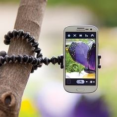 This Mini Flexible Tripod Stand can be fixed to any surface. It's compatible with any phone or camera and will keep your device perfectly still for the best picture.