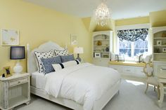 Yellow Wall Color and White Bed Furniture with blue accents