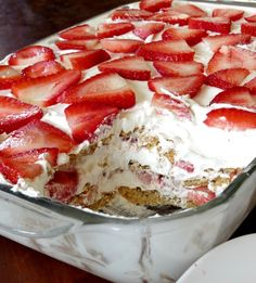 Ingredients 2 lb. strawberries 2 sleeves graham crackers 1 -8 oz. pkg. cream cheese, room temperature 1 -14 oz. can sweetened condensed milk 2- 3.4 oz. pkg. instant cheesecake flavored pudding 3 cu. milk 1- 12 oz. carton whipped topping, divided Directions Wash, cut