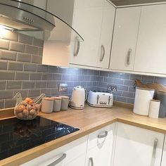 For some obscure reason, I've had an influx of questions about my kitchen, accessories and tiles. Is Insta throwing up pics of my kitchen on your suggested pages?? Who knows but here's some answers.... The grey tiles are from @homebase_uk the Kitchen doors, panels and worktops are from Howdens. Kettle and toaster are from @argoshome Cooker hood from @curryspcworld and ceramic pots are a mixture of both @asda and @dunelmuk A nice looking home needn't cost the earth #home #kitchen #inte...
