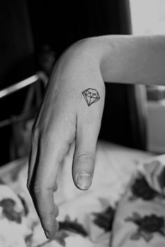 Diamond tattoo. On ring finger