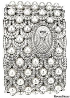 Piaget Limelight Paradise $595,195 #Piaget #watches #chronograph 18K white gold cuff bracelet set with 1,402 diamonds (approx. 23.8 ct) and 80 white Akoya pearls