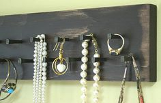 Check out our store at www.etsy.com/gardencricket/search  We have handmade this Jewelry Medals holder from wood, painted it an vintage rustic brown
