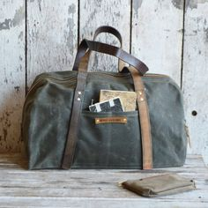 Daybag in Moss.    We meet in the middle. Our Day Bag is good for days. And nights too. It is good if you are not going away long, or if you need an