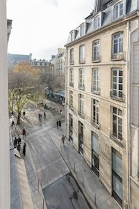Marais designer 1BR, close to everything, up to 4 guest - Saint-Gervais Paris Airbnb, Open Market, Under Stairs, Exterior Lighting, Walk In Shower, Washer And Dryer, Saints, Design, Outdoor Deck Lighting