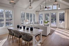 Charming great room with white shiplap walls and ceiling in a coastal cottage wi… - Modern Coastal Living Rooms, Coastal Cottage, Coastal Decor, Coastal Style, White Cottage, Cottage Entryway, Cottage Rugs, Coastal Entryway, Coastal Bedding