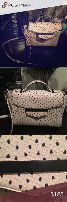 Kate Spade Satchel I can't remember the cutesy name for this bag (sorry ladies!) other than freakin' expensive. Cream color with brushstroke style dots print. Snakeskin texture. Inside of bag and hardware are in EXCELLENT condition. Only real flaw is that one of the few times I carried this, my dark denim stained the back of the bag. :( See pics, I included a close-up. Smoke-free home. kate spade Bags Shoulder Bags