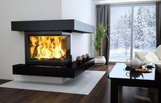 Kominki narożne pozwalają patrzeć na ogień z różnych miejsc w salonie