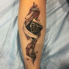 WEBSTA @ hogwartstattoo - #DeathlyHallows #tattoo by the #wizard @earthgrasper…