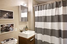 Bathroom with West Elm stripe shower curtain